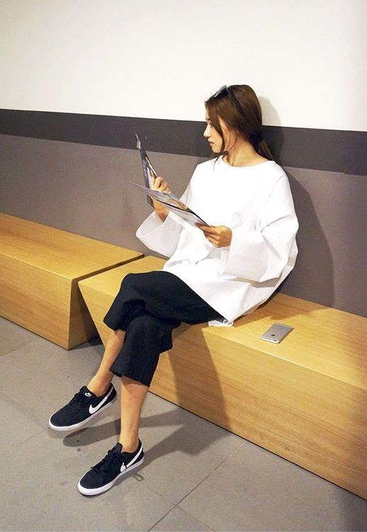 Le Fashion Blog Sporty Style Ponytail White Top With Wide Sleeves Cropped Black Trousers Nike Sneakers Via Stylenanda