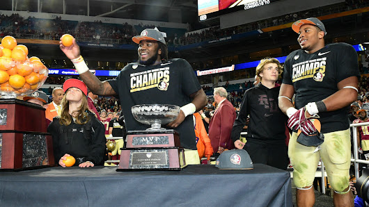Cook, Seminoles hold off Michigan in Orange Bowl