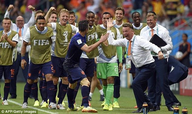 Happy Holland: Louis van Gaal high fives Van Persie after the forward's brilliant equaliser