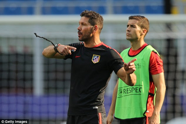 Diego Simeone gives instructions to his Atletico players as they trained at the San Siro on Thursday evening