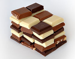 Chocolate most commonly comes in dark, milk, and white varieties, with cocoa solids contributing to the brown coloration.