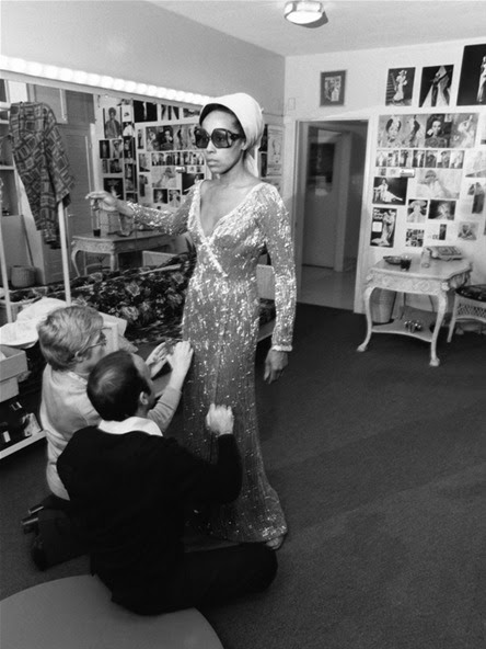 "Diahann Carroll with designers Bob Mackie and Ray Aghayan as they make adjustments on the cape and dress she wore for the 1975 Academy Awards. Ms. Carroll was nominated in the Best Actress category for her role in the film, ""Claudine."" Photo: Isaac Sutton for EBONY."