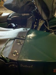 Sidecar windshield folded back to stay warm and reduce buffeting