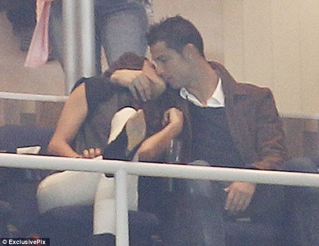 Cristiano Ronaldo and his stunning girlfriend Irina Shayk enjoyed a passionate smooch while watching a Real Madrid game