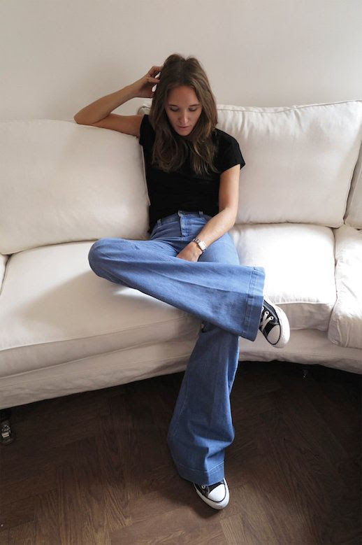 Le Fashion Blog Ways To Wear Black Converse Sneakers Plain Tee T Shirt Wide Leg Flare Jeans Denim Blogger Style Caroline Sandstrom Via Metro Mode
