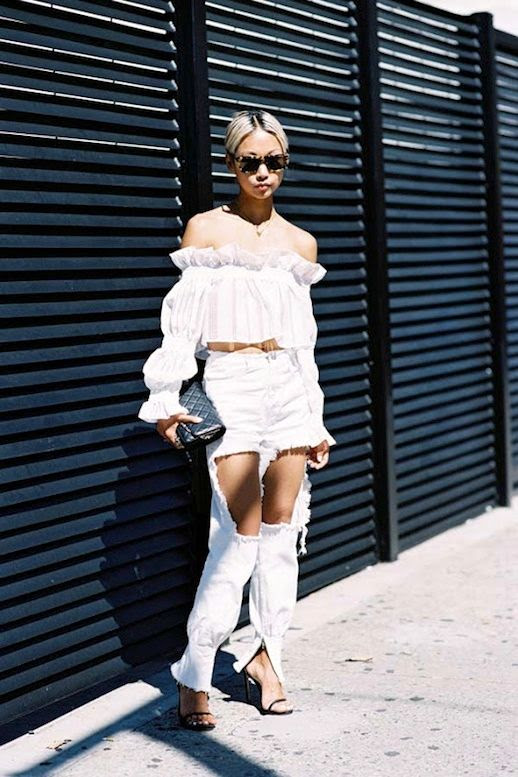 Le Fashion Blog Blogger Summer Style Vanessa Hong All White Look Tortoise Sunglasses Feminine Ruffled Off The Shoulder Top Quilted Clutch Edgy Ripped Jeans Black Heeled Sandals Via Vanessa Jackman