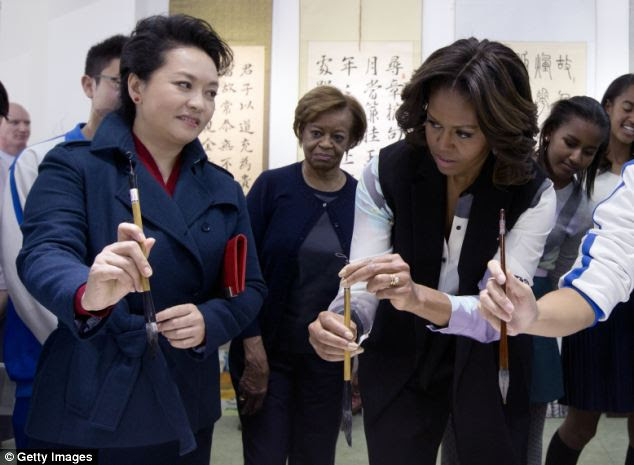 Delightful: Ordinary Chinese have described Mrs. Obama as a wonderful visitor, but her mother (at C) is allegedly causing hotel staff headaches