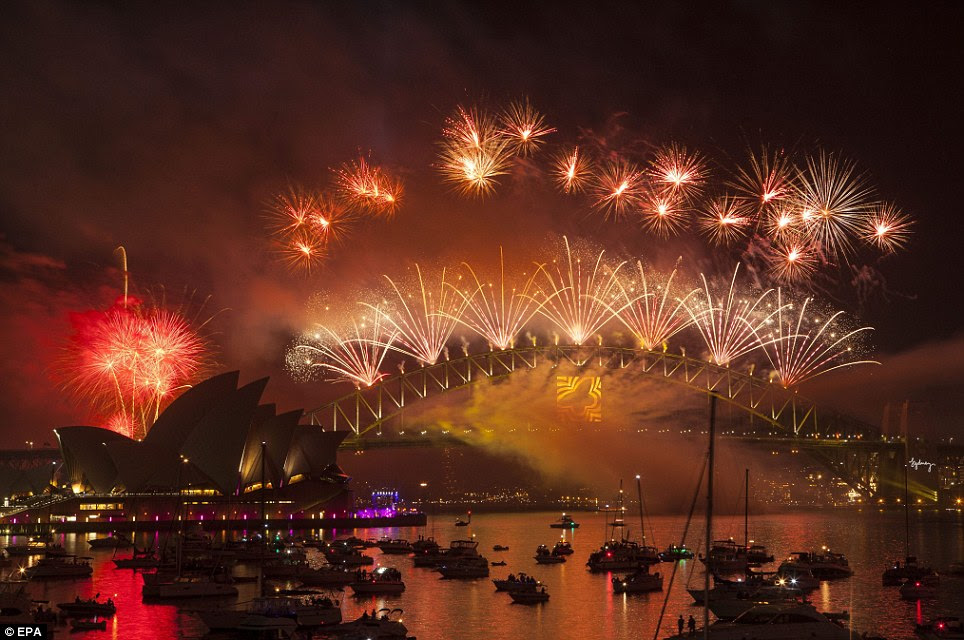 Bright: The Sydney Harbour Bridge looks impressive surrounded by colourful fireworks