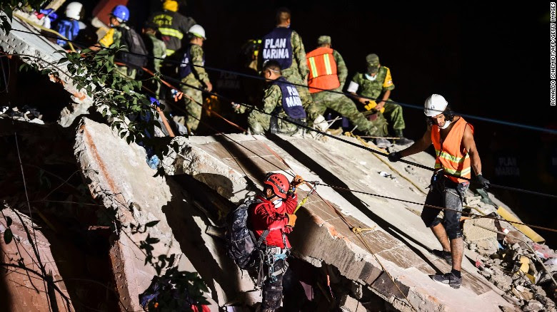 "Rescue workers remove rubble from a Mexico City building flattened by a magnitude 7.1 earthquake that struck the region Tuesday, September 19. For the second time in two weeks, a powerful temblor hit Mexico. A magnitude 8.1 quake <a href=""http://www.cnn.com/2017/09/08/americas/gallery/mexico-earthquake-2017/index.html"" target=""_blank"">struck off the country's southern coast </a>on September 8."