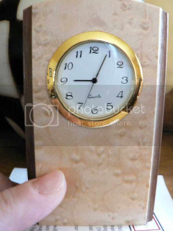 clock with thumb