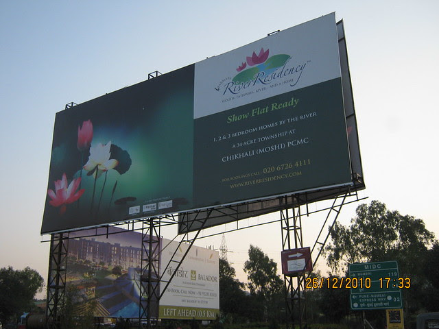 River Residency Chikhali and Balador Talegaon Hoardings at the junction near Mahavir Natura, almost Ready for Possession 1 BHK & 2 BHK Flats at Talegaon MIDC Junction on Old Mumbai Pune Highway (NH4) at Vadgaon Maval, Pune 412 106