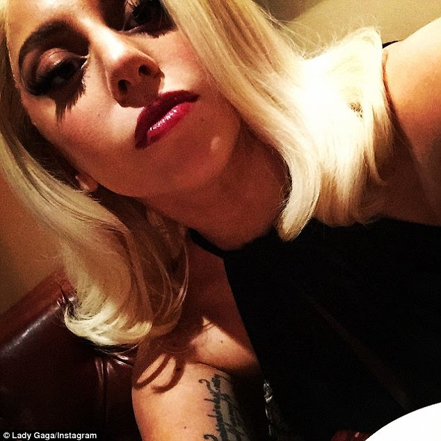 Curious: In a selfie later the same day, Gaga captioned 'Beware Vampires: the blood you choose to suck choose wisely, it may fill your pores from the inside out with a wicked poison unknown to you.'
