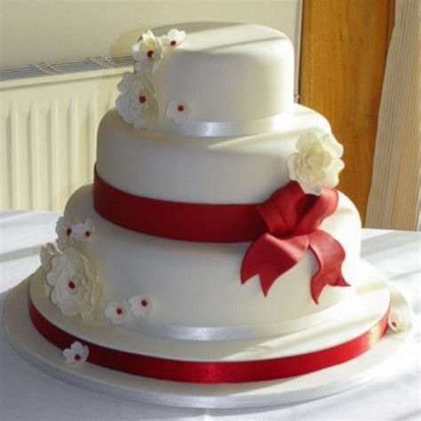Wedding Cake with Fondant Red Ribbon and Large Open Roses