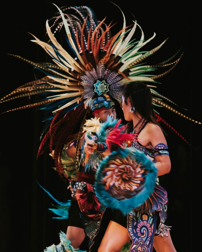 Dominique Salinas (Jicarilla Apache/Navajo) and Marcos Arellano Martinez (Mexivo, Otomi) performing a Deer Dance.