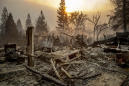 The Latest: Fire captain says wildfire destroys Calif. town