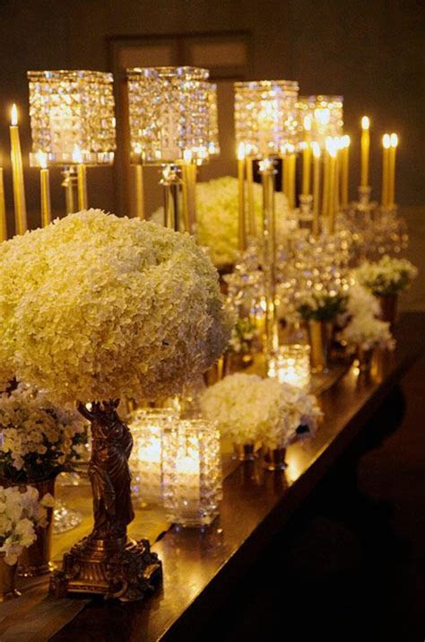 Embellished candle holders perched on gold bases are