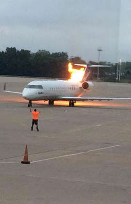Flames coming from Delta Connection jet in Nashville. Miller‏@thematt_mille