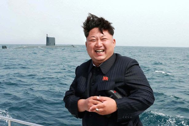 North Korean leader smoking in 2015 observing an underwater test-fire of a submarine-launched missile