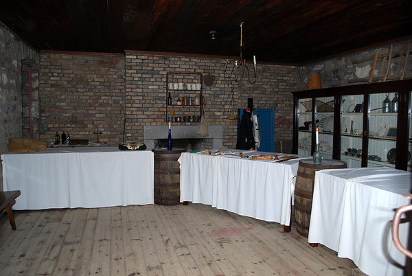 Artifacts and displays in the former storage room at Old Fort Erie.