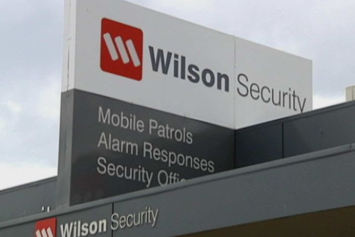 A Wilson Security sign.