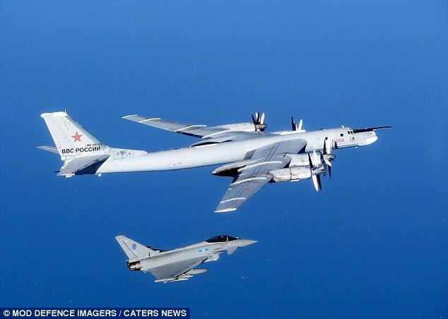 Visitante indesejado: An Typhoon RAF intercepta um urso russo ao largo da Escócia, em setembro, uma das 100 ocasiões até agora este ano que os jatos da RAF foram mexidos para atender bombardeiros russos perto do espaço aéreo britânico