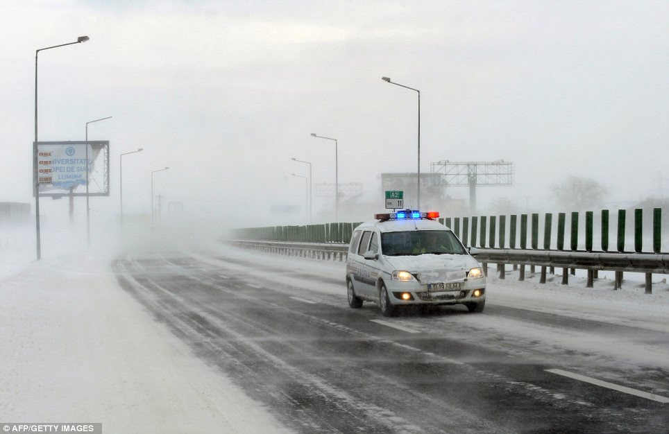 Snow patrol: A police car battles blizzards and limited visibility on the A2 motorway which connects Bucharest to Constanta