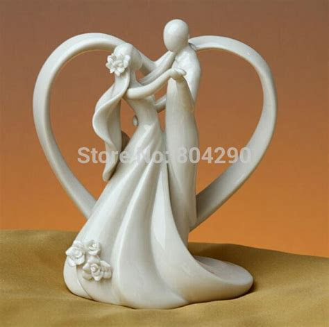 Ceramic Wedding Cake Topper Of Dancing Bride And Groom