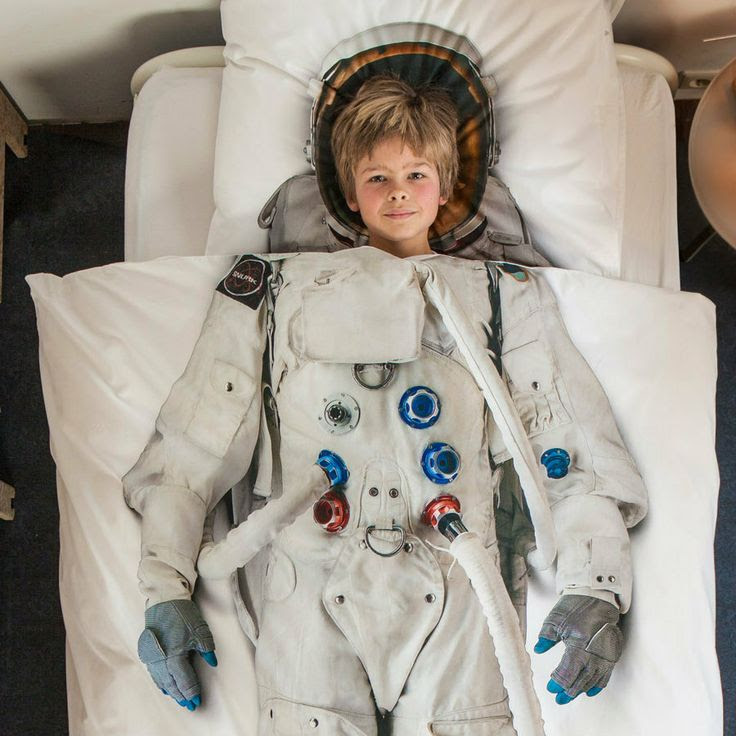 How cool is this!  For little boys who dream big! and the little one said - Snurk Astronaut Duvet, $159.95 (http://andthelittleonesaid.com.au/snurk-astronaut-duvet/)