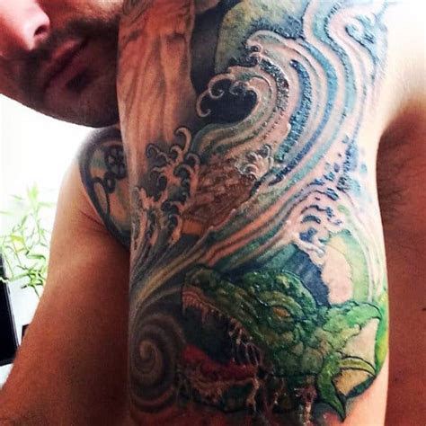 wave tattoo designs  men  ocean  manly ideas