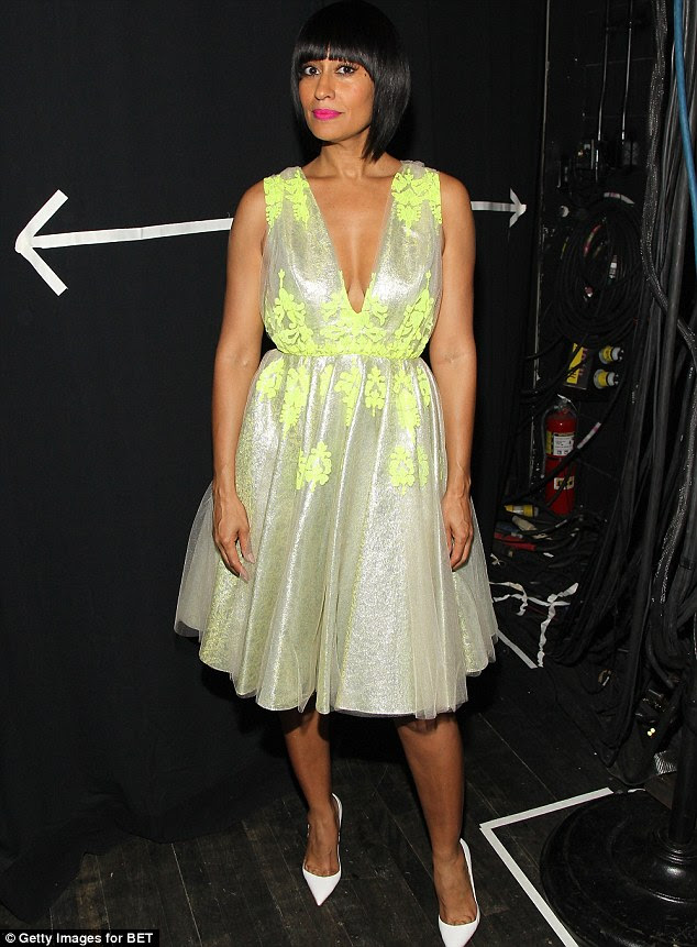 Spring forward! Ross looked gorgeous in a retro style bright green frock