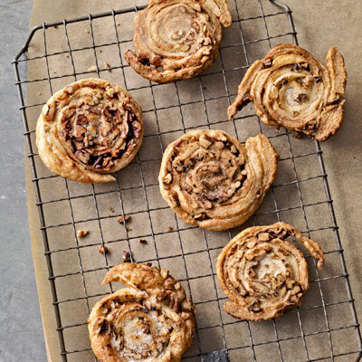 Straight from your grocer's freezer, the dough for these cinnamon-sugar and pecan-orange coated puff pastries rises to the occasion — no flour, food processor, or kneading required.Recipe: Cinnamon Pecan Spirals