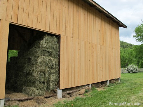 (28-35) New siding on the haybarn will help keep next winter's sheep and donkey food protected from the weather - FarmgirlFare.com