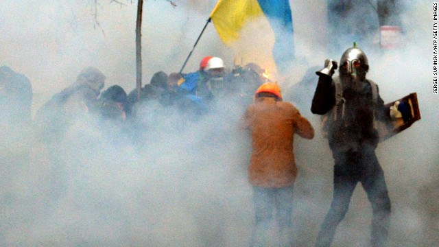 Pro-European Union demonstrators clash with police near the presidential administration office in Kiev on December 1.