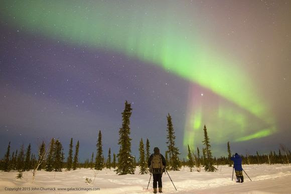Skiing stop to take in the northern lights near Fairbanks Monday night. Credit: John Chumack