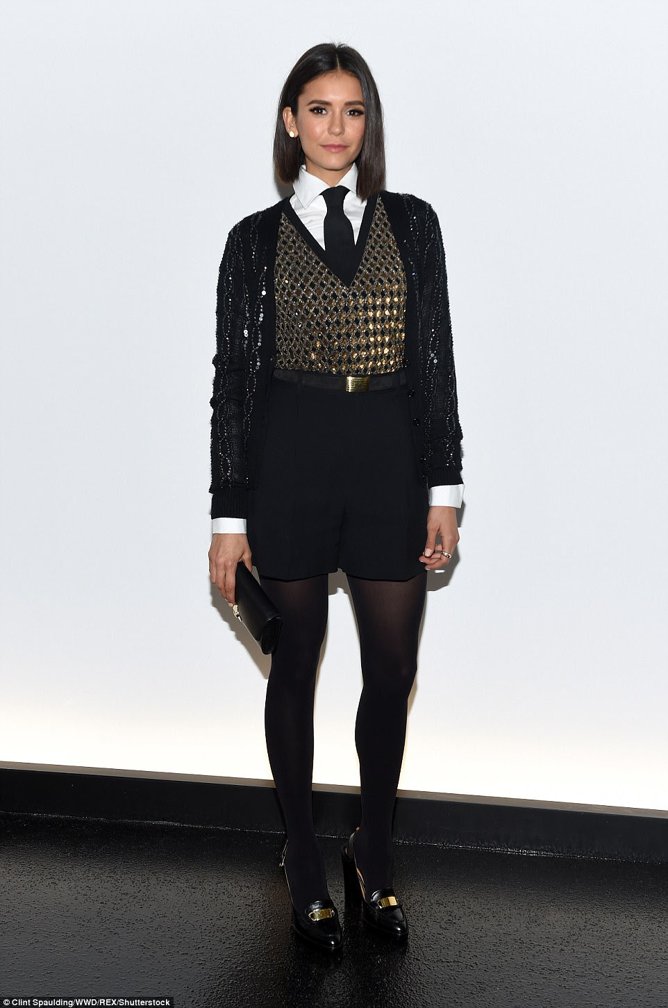Geek chic:The show attracted Nina Dobrev, who looked preppy in a white shirt and black tie. She also wore black shorts, a glittery gold vest and sequinned black cardigan all from Ralph Lauren Collection