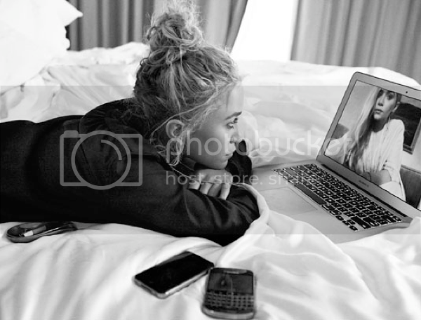 MKA MARY KATE ASHLEY OLSEN STYLE FASHION BLOG ON SKYPE  2012 CFDA JOURNAL SMOKING TOPKNOT SIDESWEPT LONG HAIR CANDID CASUAL LAPTOP BED