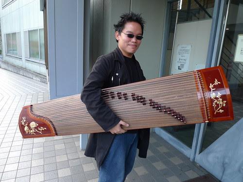 Me carrying Zhu Dan's guzheng
