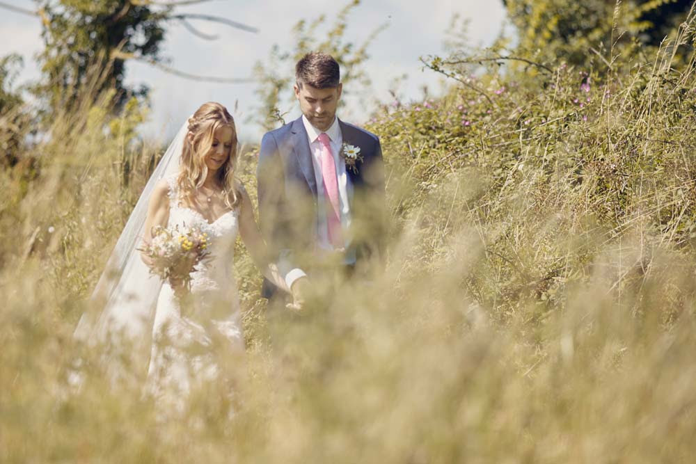 Bride and groom walking, romantic photo - www.helloromance.co.uk