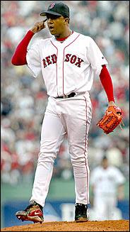 Martinez threatening the Yankee bench with further beanballs