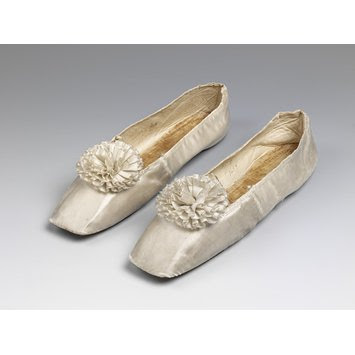 White slippers with matching rosettes, c. 1830-1840, from the Victorian and Albert Museum.
