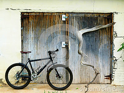 Mountain bike with weathered wood doors