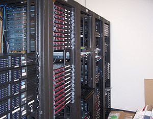 Multiple racks of servers, and how a data cent...