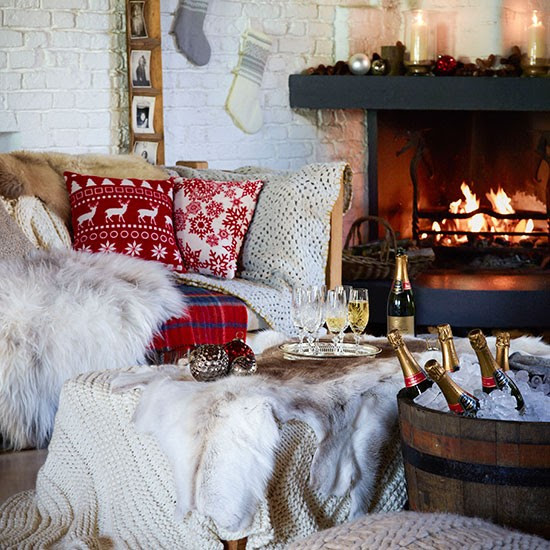 Country Christmas living room with Christmas cushions and cosy throw
