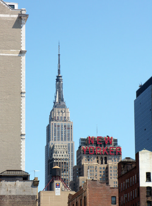 the Empire State Building and the New Yorker Hotel sign, Manhattan, NYC