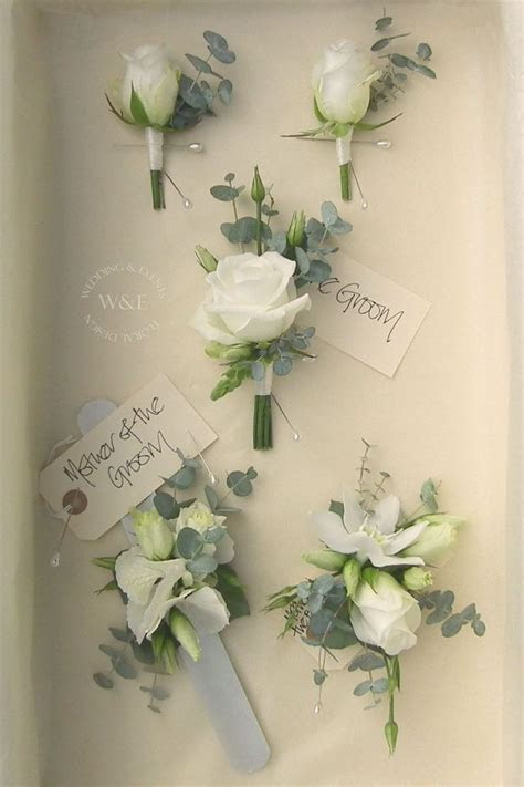 Classic White Rose and Eucalyptus Buttonholes & Corsages