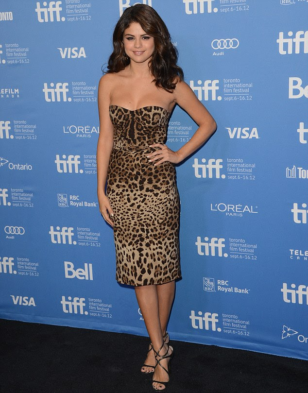 Wild for fashion: Selena wowed on the red carpet in a sexy leopard print dress for the Toronto Film Festival premiere of Spring Breakers on September 7