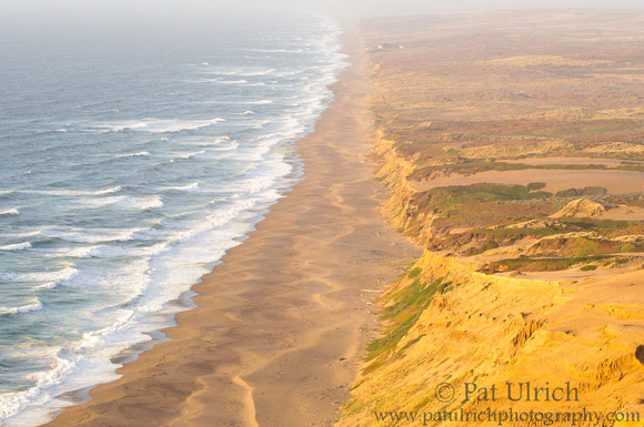 The Great Beach in Point Reyes National Seashore reflecting warm sunset colors
