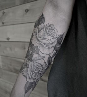 SImple black and white rose tattoo on arm