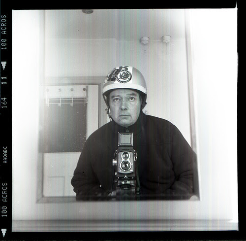 reflected self-portrait with Halma Flex camera and hard hat by pho-Tony
