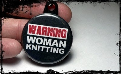 Zipper pull warning woman knitting